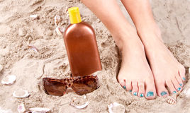 Woman with feet in sand Royalty Free Stock Photography