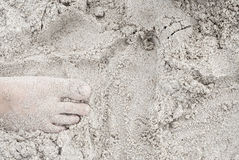 Woman feet on the sand Royalty Free Stock Photo