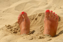 Woman feet on the sand Royalty Free Stock Image