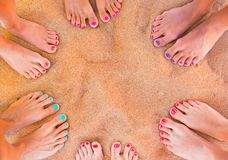 Woman feet on the sand. Six pairs of woman feet on the sand Royalty Free Stock Photos