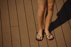 Woman feet and sandals Royalty Free Stock Image