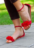 Woman feet in sandals Royalty Free Stock Images