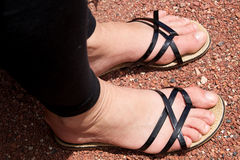 Woman feet in sandals Stock Photography