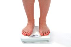 Woman Feet Scale. Woman feet on a scale as she checks her weight Stock Image
