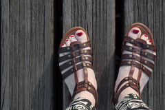 Woman feet seen from above. Sandals and red nails Royalty Free Stock Photo