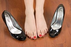 Woman feet and shoes Royalty Free Stock Photos