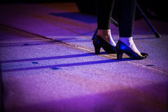 Woman feet with shoes on stage Royalty Free Stock Images