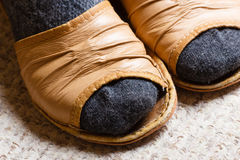 Woman feet with socks in slippers at home Stock Photography