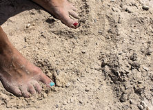 Woman feet standing on a sand Royalty Free Stock Image