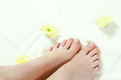 Woman feet standing on towel Stock Photos