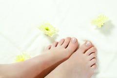 Woman feet standing on towel Stock Photos