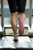 Woman Feet On Treadmill Royalty Free Stock Photography