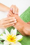 Woman feet undergoing massage royalty free stock images