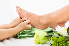 Woman feet undergoing massage Royalty Free Stock Photography