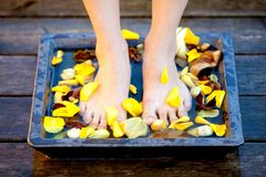 Woman feet into water Royalty Free Stock Image
