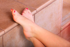 Woman feet in water at poolside. Stock Image