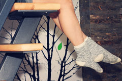 Woman feet  wearing cozy warm wool socks close up. Warmth concept. Winter clothes Royalty Free Stock Photo