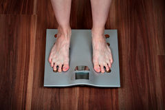 Woman feet on weight scale Stock Photography