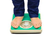 Woman feet and weight scale Stock Photography