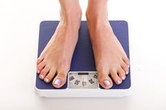 Woman feet and weight scale isolated on white background Royalty Free Stock Photography
