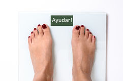 Woman feet on weight scales royalty free stock photo