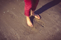 Woman feet in wet sand. On beach Royalty Free Stock Image