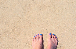 Woman feet on white sand. White coral beach by sea. Sunny tropical seaside. Royalty Free Stock Photography
