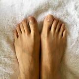 Closeup female feet on white towel. CloseupPhoto of female feet on white towel stock images
