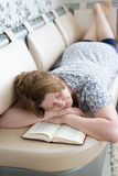 The woman fell asleep while reading  book Royalty Free Stock Photos