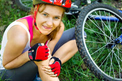 Woman fell off mountain bike. Stock Photos
