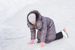 Woman fell on the rink Royalty Free Stock Photos