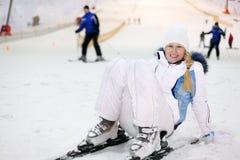 Woman fells on ski in indoor ski Stock Image