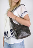 Woman  with female hand bag Royalty Free Stock Photography