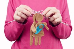 Woman female knits silhouette of woman and man in love. With newborn baby by knitted needles. Family concept Stock Images
