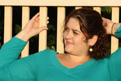 Woman on a fence Stock Photography