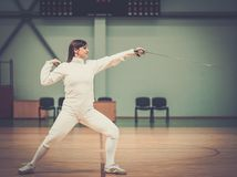 Woman on a fencing trainer Stock Image