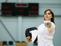 Woman on a fencing trainer Royalty Free Stock Photography
