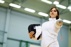 Woman on a fencing trainer Stock Photo