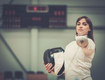 Woman on fencing training Stock Photos