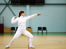 Woman on fencing training Stock Photography