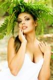 Woman in fern wreath Stock Photo