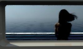 Woman on ferry. Rainy gloomy ferry boat ride Stock Photo