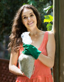 Woman with fertilizer granules in bag Royalty Free Stock Photos