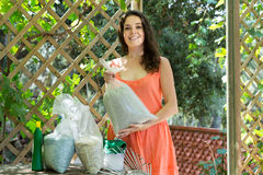Woman with fertilizer granules in bag Royalty Free Stock Photography
