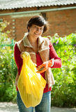 Woman fertilizes the soil Stock Image