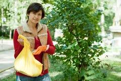Woman fertilizes the soil Royalty Free Stock Photography