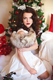 Woman in festive dress and fur at Christmas time Royalty Free Stock Photography