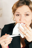Woman with fever and cold Royalty Free Stock Photos