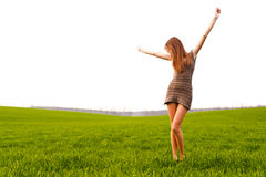 Woman in field. Young woman in green field with arms raised Royalty Free Stock Photo