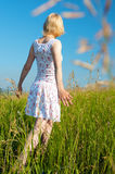 Woman in field Stock Photo